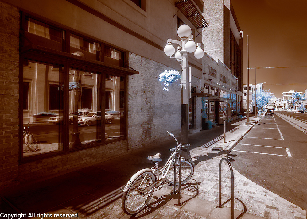 Infrared (IR) image - Let's get this straight from the get go - the Arizona IR series has nothing to do with any upcoming moves.  I plan to live here for a long, long, time.  I used the IR camera for this image because I feel the brown and pastel blue tones lend themselves to a feeling of nostalgia that worked well with the old style bicycle and lamp post.