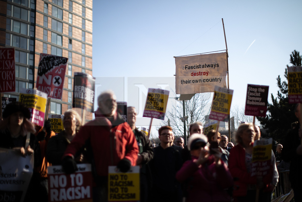 "© Licensed to London News Pictures . 23/02/2019. Salford, UK. ANTI FASCIST COUNTER PROTESTERS with a banner reading "" Fascist always destroy their own country "" . Supporters of Tommy Robinson (real name Stephen Yaxley-Lennon ) and anti-fascists opposed to the former EDL leader and his followers , gather near to the BBC at Media City to protest , as Yaxley-Lennon hosts a rally showing a home-made documentary , "" Panodrama "" , described as an exposé of the BBC's Panorama documentary series . A BBC Panorama documentary is due to feature an investigation in to Yaxley-Lennon in the near future . Photo credit: Joel Goodman/LNP"