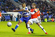 Reading midfielder Andy Rinomhota (8) tussles with Luton Town midfielder Andrew Shinnie (11) during the EFL Sky Bet Championship match between Reading and Luton Town at the Madejski Stadium, Reading, England on 9 November 2019.