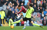 Burnley striker Andre Gray (7) shoots as Brighton captain and central defender, Gordon Greer (3) closes down during the Sky Bet Championship match between Burnley and Brighton and Hove Albion at Turf Moor, Burnley, England on 22 November 2015.