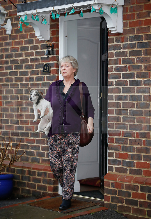 """© Licensed to London News Pictures. 15/01/2018. Maidstone, UK. JAYNE MARNEY, mother of Jo Marney, seen leaving the family home in Kent with a pet dog, saying Jo Marney had """"Gone to Disneyland"""". UKIP party leader Henry Bolton has said he is no longer in a relationship with Ms Marney. Mr Bolton is under pressure after his partner, glamour model Jo Marney, wrote offensive text messages to friend. She has been suspended from the party. Photo credit: Peter Macdiarmid/LNP"""