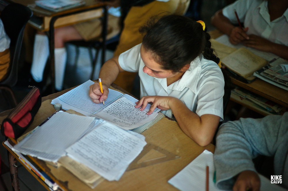 A girl doing homework at a countryside school in Sancti Spiritus Region