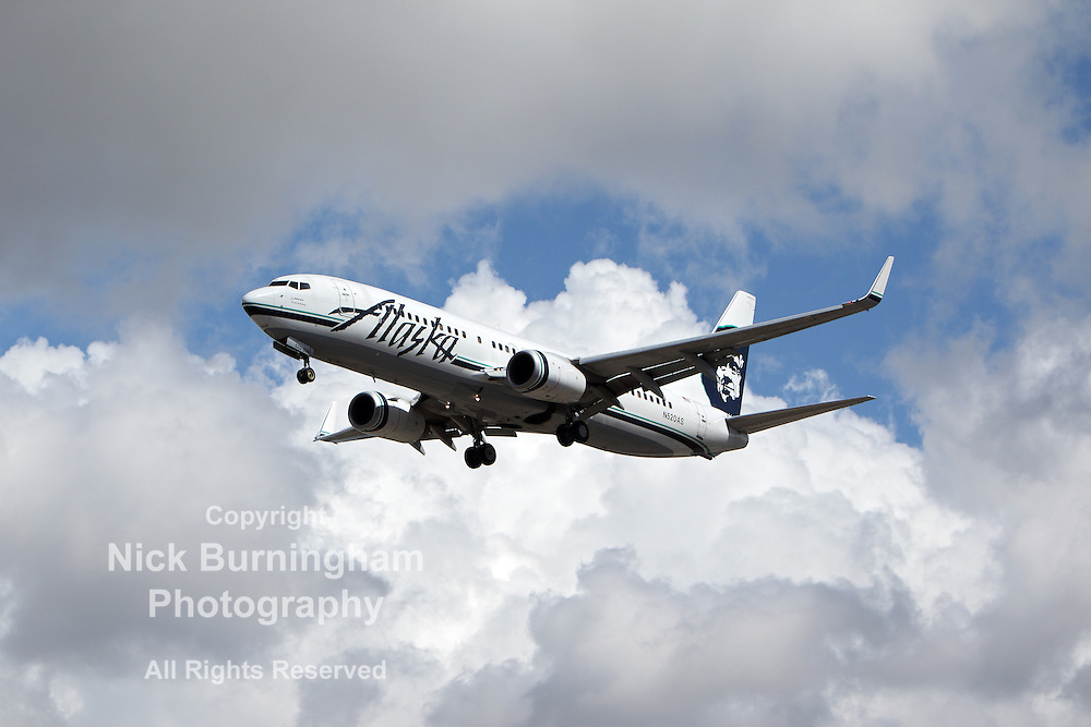 LOS ANGELES, CALIFORNIA, USA - MARCH 8, 2013 - Alaska Airlines Boeing 737-890 lands at Los Angeles Airport on March 8, 2013. The plane has a range of 5,765 km with 160 seats.
