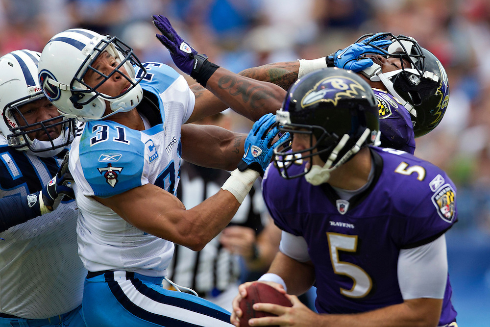 NASHVILLE, TN - SEPTEMBER 18:   Ray Rice #27 of the Baltimore Ravens and Cortland Finnegan #31 of the Tennessee Titans put their hands to the face mask at the LP Field on September 18, 2011 in Nashville, Tennessee.  (Photo by Wesley Hitt/Getty Images) *** Local Caption *** Ray Rice; Cortland Finnegan