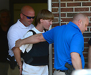 Jun 18, 2015 - Charleston, South Carolina, U.S. - <br /> <br /> Charleston Church Shooting<br /> <br /> Shelby Police escort suspected gunman DYLANN ROOF off the premises. Roof was arrested on U.S. 74 near the intersection of Plato Lee Road during a traffic stop. Roof is suspected of fatally shooting nine people Wednesday night at the historic Emanuel African Methodist Episcopal Church in Charleston.<br /> ©Exclusivepix media