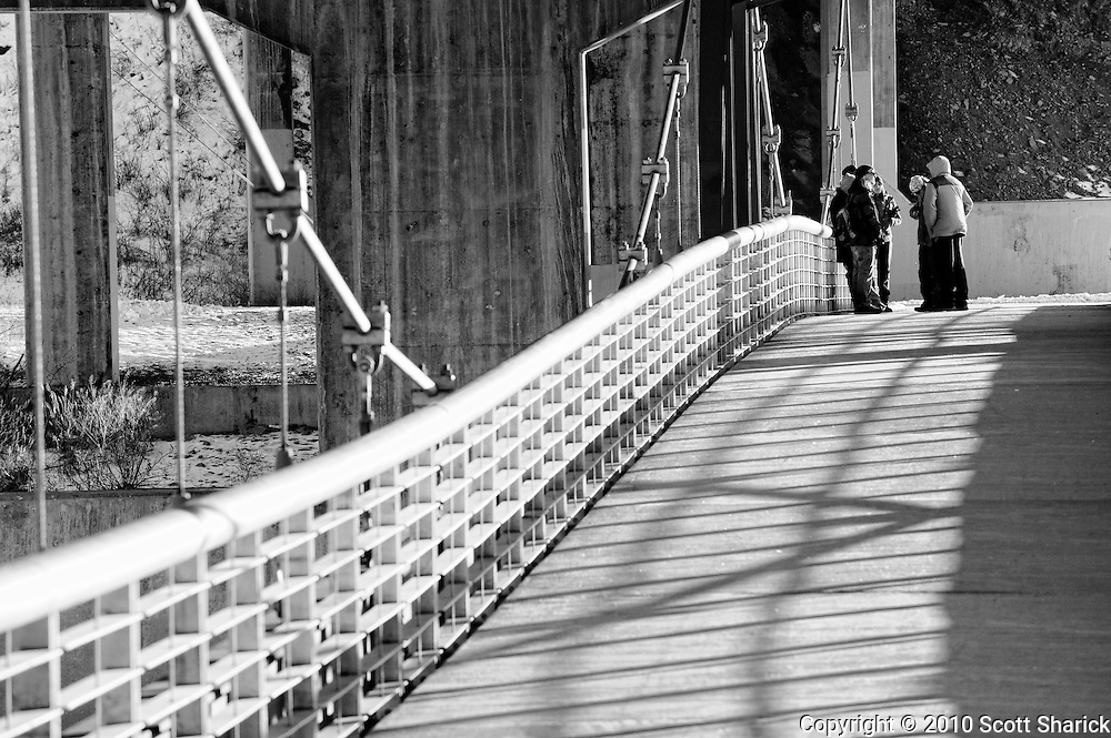 A group of young people meet under the Madison Street bridge in Missoula, Montana for a group meeting. Missoula Photographer, Montana Photographer, Pictures of Missoula, Montana Photos
