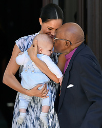 Baby Archie is kissed on the forehead by Archbishop Desmond Tutu while in the hands of his mother The Duchess of Sussex in cape Town, on day three of their tour of Africa.