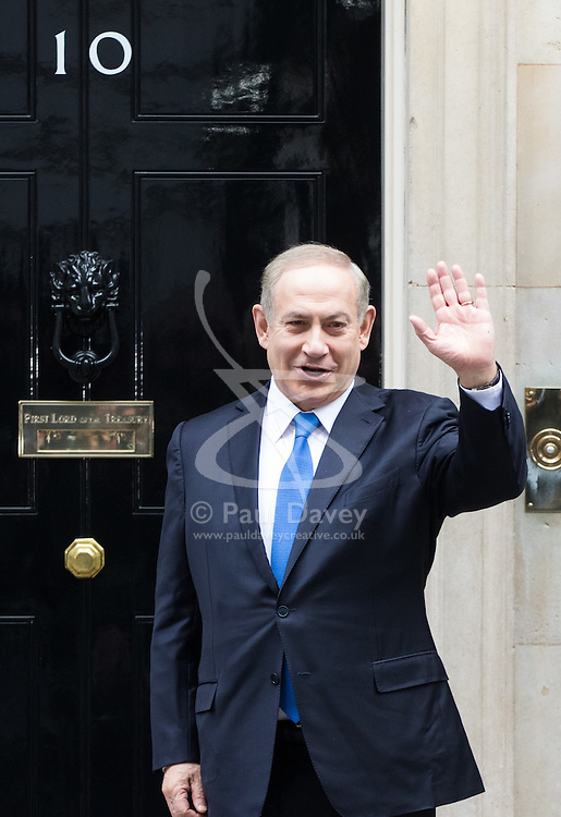 Downing Street, London, February 6th 2017. Israeli Prime Minister Benjamin Netanyahu arrives at 10 Downing Street for lunchtime talks with British Prime Minister Theresa May, with some confusion arising when Mrs May was not immediately on hand to welcome him. Minutes later the two PMs emerged for the traditional handshake photographs at the door of No 10. PICTURED: Netanyahu waves to the press as he waits for Theresa May to welcome him and to pose for the traditional handshake pictures.