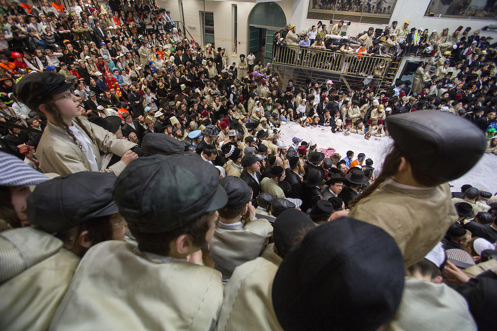 Ultra-orthodox boys dressed in costume at  Toldot Aharon Hasidic dynasty synagogue during Purim tish. Jerusalem, Israel, 25 February 2013.  Photo by Oren Nahshon.