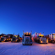 Ian Stewart/Yukon News<br /> Rigs headed for Inuvik and points beyond warm up at dawn at the Eagle Plains Hotel. <br /> <br />  &copy; 2013 IAN STEWART PHOTOGRAPHY