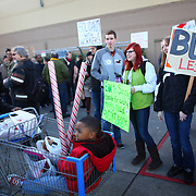 Protesters gather in front of Walmart in Renton during an Occupy Seattle protest at the retailer on Friday, November 25, 2011. A few dozen protesters gathered in front of the store and briefly marched through the store during the Black Friday protest. (Joshua Trujillo, seattlepi.com)