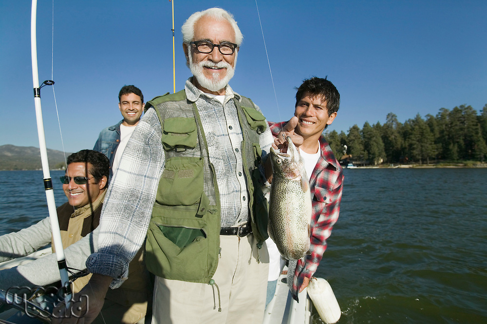 Father and Sons on Fishing Boat with Nice Fish