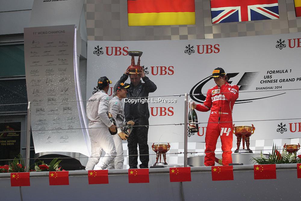 &copy; Photo4 / LaPresse<br /> 20/4/2014 Shanghai, China<br /> Sport <br /> Grand Prix Formula One China 2014<br /> In the pic: Podium, winner Lewis Hamilton (GBR) Mercedes AMG F1 W05, 2nd Nico Rosberg (GER) Mercedes AMG F1 W05 and 3rd Fernando Alonso (ESP) Scuderia Ferrari F14T