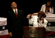 Newark Mayor Cory Booker is thanked by the new Council President Mildred C. Crump at the Inauguration and Organization Meeting for the Mayor and Municipal Council held at the New Jersey Performing Arts Center in Newark on July 1, 2006.
