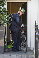 © Licensed to London News Pictures. 18/06/2015. London, UK. Mayor of London BORIS JOHNSON leaving his London home on his bike a day after video footage emerged of him swearing at a black cab driver. Photo credit: Ben Cawthra/LNP