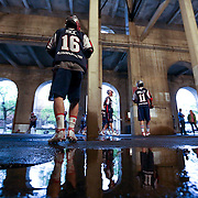 Jack Rice #16 of the Boston Cannons and other members of the team warm up in the concourse prior to taking the field at the end of a rain delay during the game at Harvard Stadium on May 10, 2014 in Boston, Massachusetts. (Photo by Elan Kawesch)