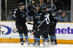 April 4, 2011; San Jose, CA, USA;  San Jose Sharks center Joe Pavelski (8) celebrates with center Kyle Wellwood (20), defenseman Marc-Edouard Vlasic (44) and center Torrey Mitchell (17) after scoring a goal against the Los Angeles Kings during the first period at HP Pavilion. Mandatory Credit: Jason O. Watson / US PRESSWIRE