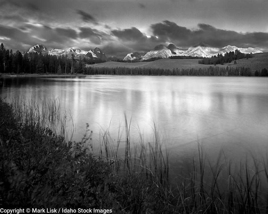 The Sawtooth mountains reflect into Little Redfish Lake.