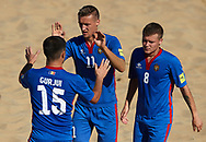 CATANIA, ITALY - AUGUST 16: Nicolae Ignat of Moldova celebrates after scoring with his teammates Cristian Gurjui and Corneliu Pavalachi  during the Euro Beach Soccer League match between Moldova and Estonia on August 16, 2019 in Catania, Italy. (Photo by Quality Sport Images