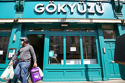 "© Licensed to London News Pictures. 24/05/2020. London, UK. An Uber Eats driver leaves 'GOKYUZU' a Turkish restaurant on Green Lanes, Haringey in north London which is open for take away only, as Muslims celebrate Eid al-Fitr. On Eid al-Fitr also known as ""Festival of Breaking the Fast"", a religious holiday celebrated by Muslims worldwide that marks the end of the month-long fasting of Ramadan, restaurants would normally be packed with people celebrating Eid. Photo credit: Dinendra Haria/LNP"
