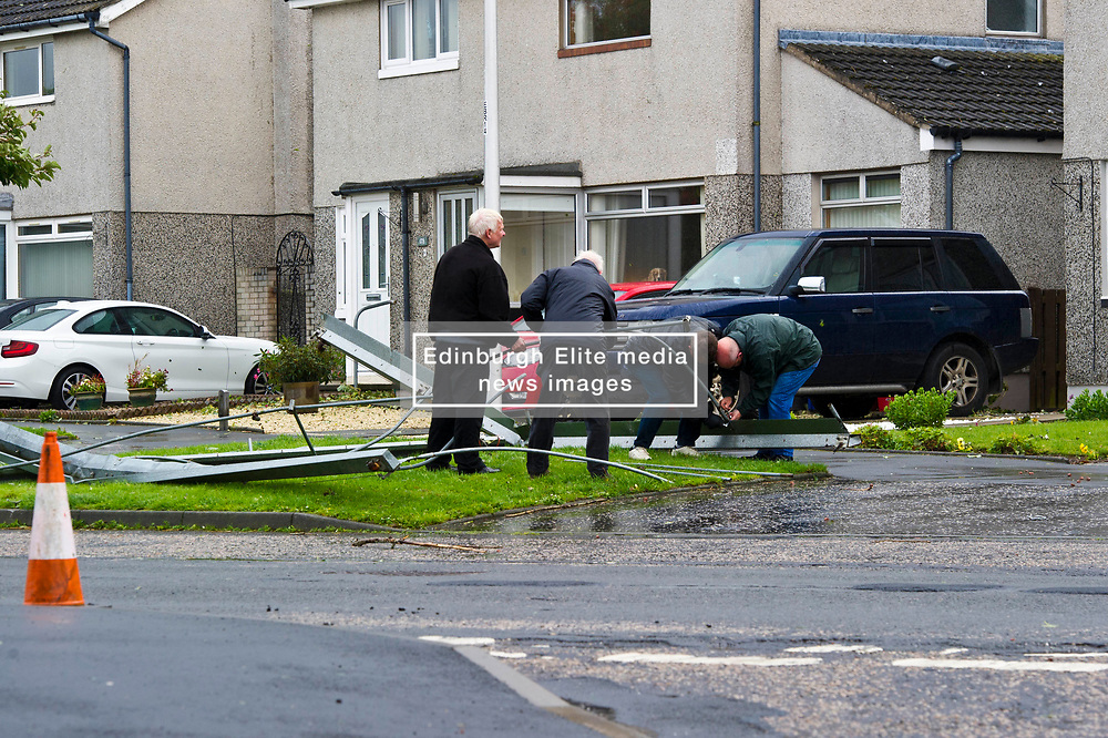 Pictured: <br /> <br /> Stoem Ali was no friend to motorists or householders in Penicuik today with trees bloacking half the road and a cricket cover being blown over a house and into the street; narrowly missing a parrked car.  Thankfully no injuries have been reported but some shed are no long standing true.<br /> <br /> Ger Harley   EEm date