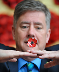Veterans Minister Keith Brown MSP visited the Poppy Scotland workshop in Edinburgh to unveil the specially designed centenary poppy, to mark 100 years since the end of the First World War.<br /> <br /> © Dave Johnston/ EEm