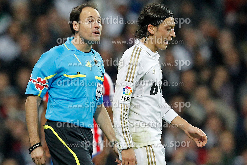 26.11.2011, Santiago Bernabeu Stadion, Madrid, ESP, Primera Division, Real Madrid vs Atletico Madrid, 14. Spieltag, im Bild Real Madrid's Mesut Ozil // // during the football match of spanish 'primera divison' league, 14th round, between Real Madrid and Atletico Madrid at Santiago Bernabeu stadium, Madrid, Spain on 2011-11-26. EXPA Pictures © 2011, PhotoCredit: EXPA/ Alterphotos/ Cesar Cebolla, ***** ATTENTION - OUT OF ESP and SUI *****. EXPA Pictures © 2011, PhotoCredit: EXPA/ Alterphotos/ Cesar Cebolla..***** ATTENTION - OUT OF ESP and SUI *****
