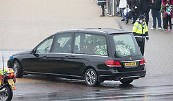 The funeral cortege arrives at Celtic Park. The funeral of former footballer Tommy Gemmell.