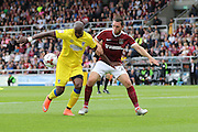 AFC Wimbledon striker Tom Elliott (9) and Northampton Town midfielder John-Joe O'Toole (21) in action during the EFL Sky Bet League 1 match between Northampton Town and AFC Wimbledon at Sixfields Stadium, Northampton, England on 20 August 2016. Photo by Stuart Butcher.