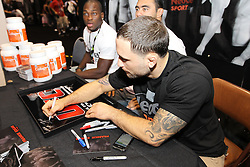 October 7, 2011; Houston, TX.; USA;  UFC Lightweight Champion Frankie Edgar signs autographs for fans at the UFC 136 Fan Expo at the George R. Brown Convention Center in Houston, TX.