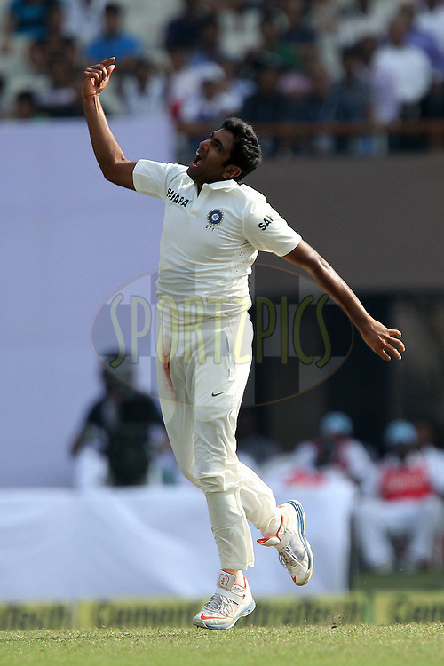 Ravichandran Ashwin of Indiacelebrates the wicket of Veerasammy Permaul of West Indies during day one of the first test match between India and The West Indies held at The Eden Gardens Stadium in Kolkata, India on the 6th November 2013<br /> <br /> Photo by: Ron Gaunt - BCCI - SPORTZPICS