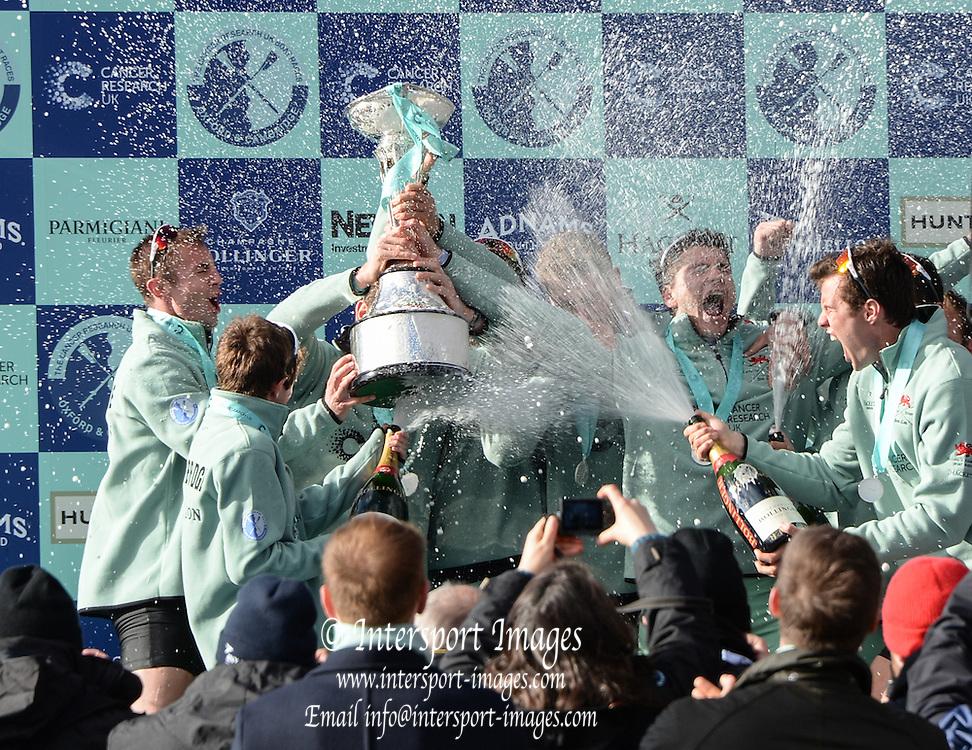 London. UNITED KINGDOM. &quot;Champagne Moment&quot;, Cambridge celebrate winning the  162nd BNY Mellon Boat Race Championship Course, River Thames, Putney/Mortlake.  Sunday  27/03/2016    [Mandatory Credit. Intersport Images]<br /> <br /> Cambridge University Boat Club {CUBC} v Oxford University Boat Club {OUBC}<br /> <br /> Cambridge, Crew, Bow: Felix Newman &ndash; 83.2kg, 2: Ali Abbasi &ndash; 88.4kg, 3: Charles Fisher &ndash; 91.8kg, 4: Clemens Auersperg &ndash; 90.4kg, 5: Luke Juckett &ndash; 82.0kg, 6: Henry Hoffstot &ndash;  92.6kg, 7: Ben Ruble &ndash; 83.4kg, Stroke: Lance Tredell &ndash; 94.2kg, Cox: Ian Middleton &ndash; 54.0kg