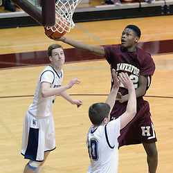 TOM KELLY IV - DAILY TIMES<br /> Haverford's Cameron Reddish (22) goes up for a layup over Episcopal's Conner Delaney (10) during the Episcopal Academy vs The Haverford School boys basketball game as part of the Daniel Dougherty tournament at Philadelphia University on Saturday, January 3, 2015.