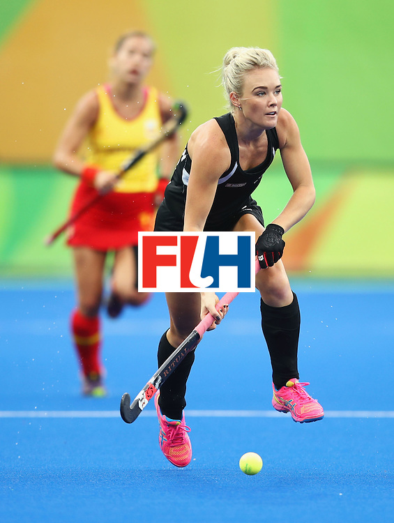 RIO DE JANEIRO, BRAZIL - AUGUST 10:  Charlotte Harrison of New Zealand dribbles the ball during the Women's Pool A Match between Spain and New Zealand on Day 5 of the Rio 2016 Olympic Games at the Olympic Hockey Centre on August 10, 2016 in Rio de Janeiro, Brazil.  (Photo by Mark Kolbe/Getty Images)