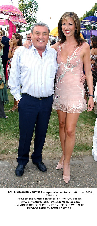SSOL & HEATHER KERZNER at a party in London on 16th June 2004.<br /> PWG 411