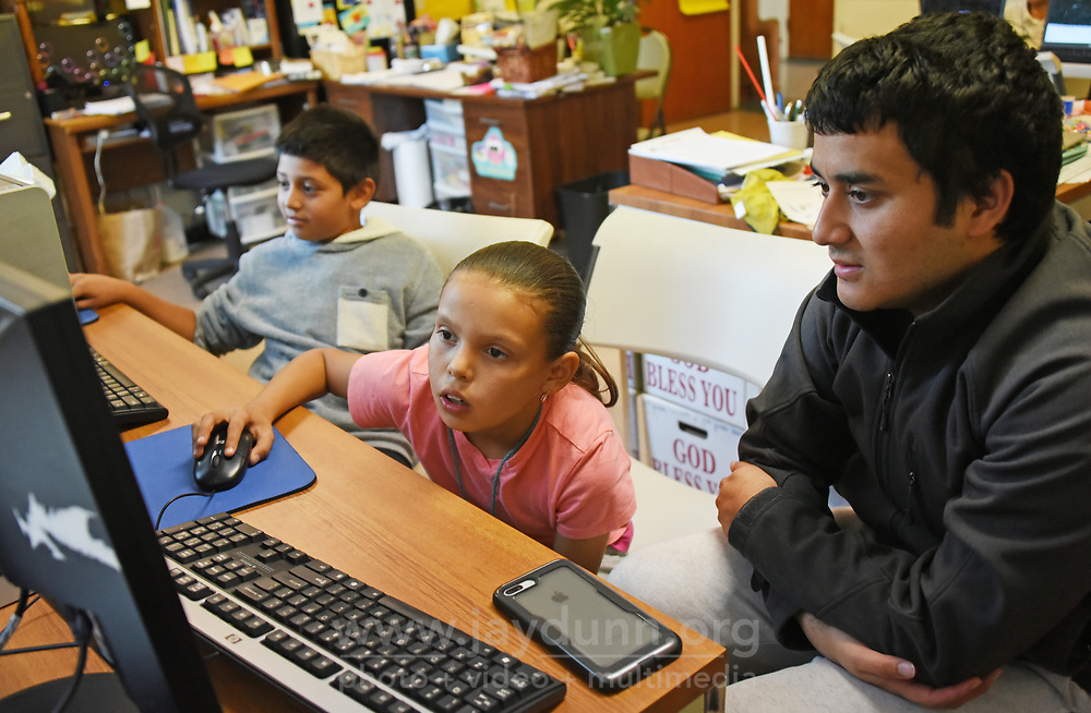 Stephanie Zarate gets some after-school coding instruction from LIFE tutor and CSUMB student Daniel Calderon.