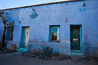 House with blue stucco wall and teal door frame, Architecture, Hearst Castle. Fine art photography prints for sale.