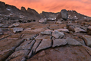 Sunset and alpine glow light on the Four Gables Peak  with unique glacial rock formations above Upper French Lake during a backpacking trip in the High Sierra mountains outside of Bishop, CA, July, 2016.
