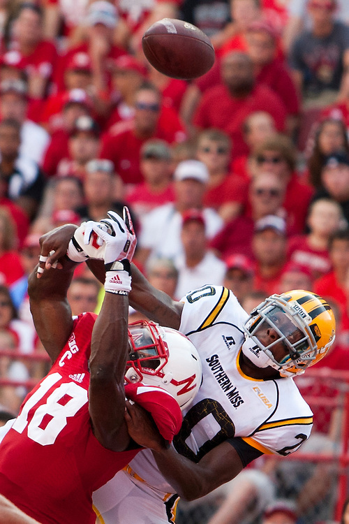 Nebraska Cornhuskers wide receiver Quincy Enunwa (18) goes for a pass in front of Southern Miss Golden Eagles defensive back Ed Wilkins (20) during their Saturday Sept 7, 2013 NCAA football game in Lincoln, Neb.(Photo by/John S Peterson)
