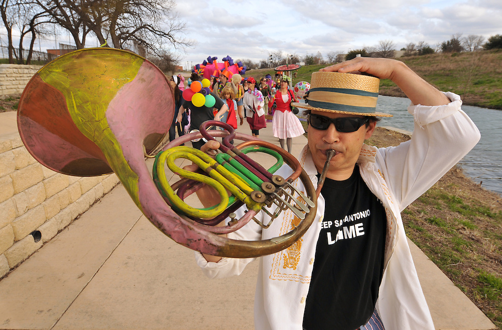 A horn player leads the parade that kicked off Contemporary Art Month (CAM) in San Antonio, Texas.