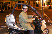 FRA_040619_004_x.Olivier Dumont on his new motor scooter, Paris, France..