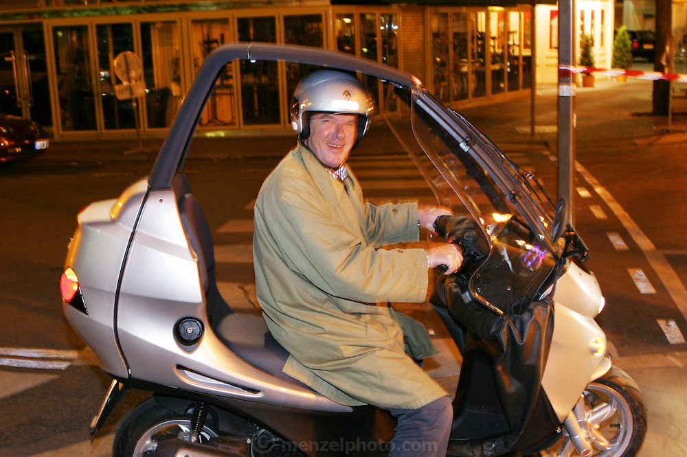 FRA_040619_004_x.Olivier Dumont on his new motor scooter, Paris, France..
