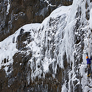 "Róbert Halldórsson on the ice climb "" Svartur Afgan"" WI5 80m, at Tröllhamrar, Breiðdalur. East Iceland."