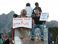 CAPE TOWN, SOUTH AFRICA - Thursday 9 April 2015, students on top of the base that once held the statue in place stand in defiance and sing struggle songs during the removal of the statue of CECIL JOHN RHODES at the University of Cape Town. Rhodes (5 July 1853 &ndash; 26 March 1902) was a British businessman, mining magnate, and politician in South Africa. An ardent believer in British colonialism, Rhodes was the founder of the southern African territory of Rhodesia, which was named after him in 1895. South Africa's Rhodes University is also named after Rhodes. He set up the provisions of the Rhodes Scholarship, which is funded by his estate. <br /> Photo by Roger Sedres/ ImageSA