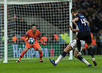 Football - 2018 / 2019 UEFA Champions League - Group B: Tottenham Hotspur vs. Inter Milan<br /> <br /> Ivan Perisic (Inter Milan) gets his shot away as Jan Vertonghen (Tottenham FC)  comes across to block at Wembley Stadium.<br /> <br /> COLORSPORT/DANIEL BEARHAM