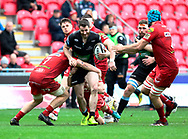 Glasgow Warriors' Tommy Seymour under pressure from Scarlets' James Davies<br /> <br /> Photographer Simon King/Replay Images<br /> <br /> Guinness PRO14 Round 19 - Scarlets v Glasgow Warriors - Saturday 7th April 2018 - Parc Y Scarlets - Llanelli<br /> <br /> World Copyright © Replay Images . All rights reserved. info@replayimages.co.uk - http://replayimages.co.uk