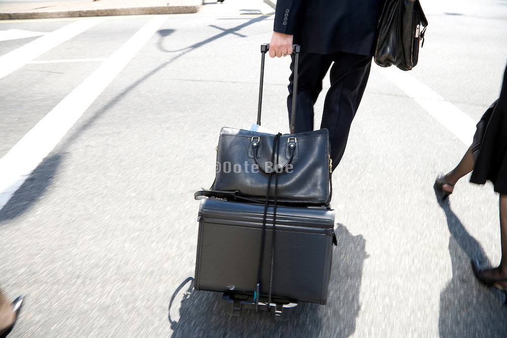 businessman end women with heavy briefcases on there way to a meeting