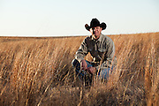 Jeff Haley, a land-owner and rancher near Pampa, Texas, sits among native grasses, natural to lesser prairie chicken environments. However, Haley says he sees fewer chickens every year.