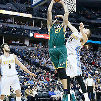 20 November 2016: Utah Jazz center Rudy Gobert (27) goes for the dunk over Denver Nuggets forward Nikola Jokic (15) during the Denver Nuggets 105-91 victory over the Utah Jazz, at the Pepsi Center, Denver, Colorado, USA.