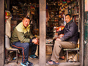 06 MARCH 2017 - KATHMANDU, NEPAL:  Men in a small shop that sells food and snacks in Kathmandu.      PHOTO BY JACK KURTZ